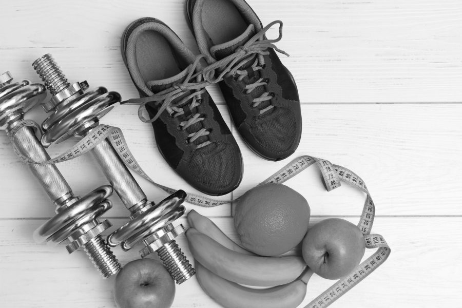 fitness+equipment+and+healthy+nutrition+on+white+wooden+plank+floor