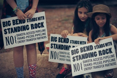 Young girls hold signs that draw connections between Trans-Pecos and the Dakota Access Pipeline. Photo courtesy of BBCA