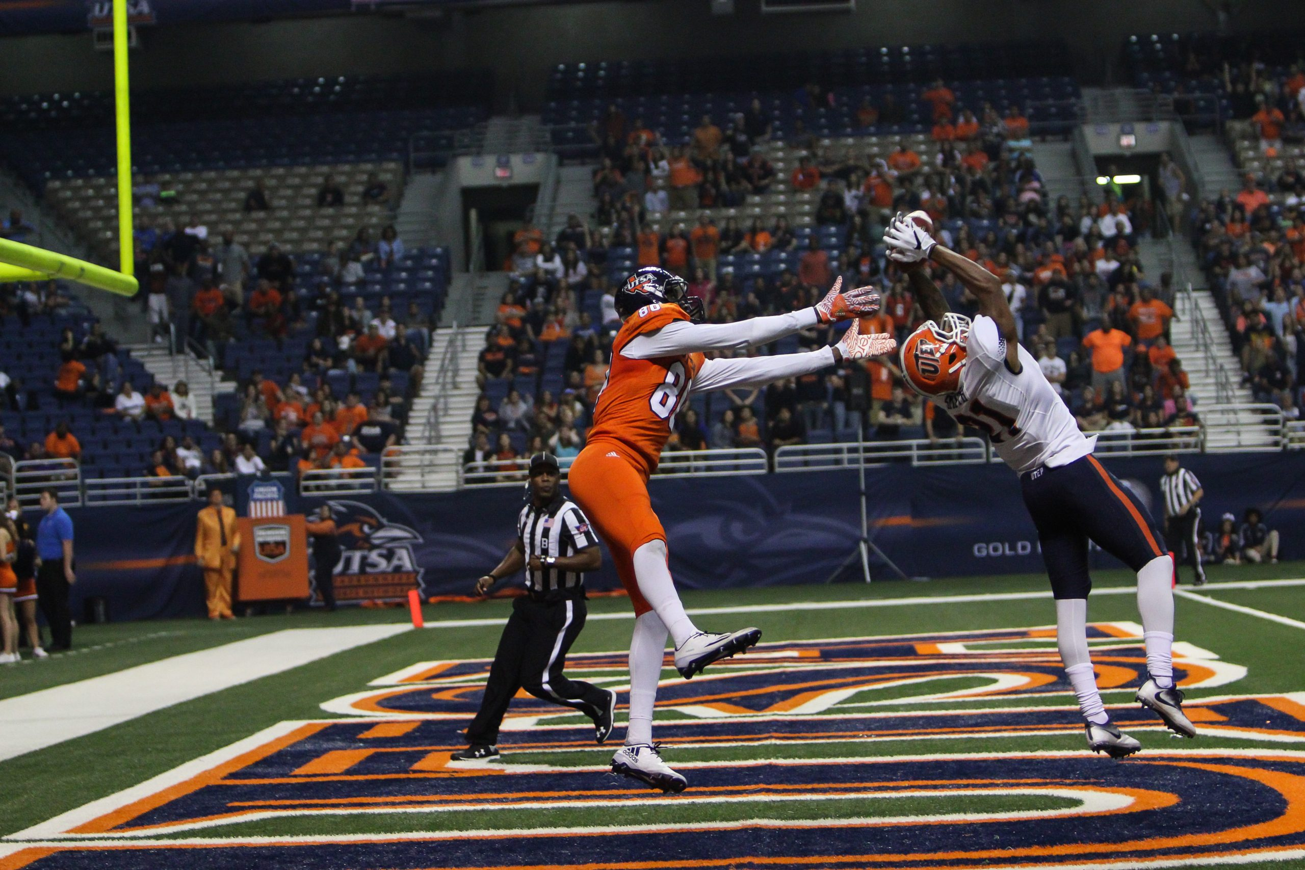 Defensive back Dashone Smith of UTEP intercepts a pass to wide reciever Josh Stewart in the second half of Saturday's game between UTSA and UTEP at the Alamodome. UTSA lost in quintuple-overtime 52-49. David Guel, The Paisano