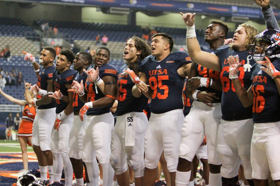 Players sing the Alma Mater after their 55-33 victory over Southern Mississippi. The win was a morale booster for the Roadrunners after their rough 1-3 start to the season. Photos by David Guel