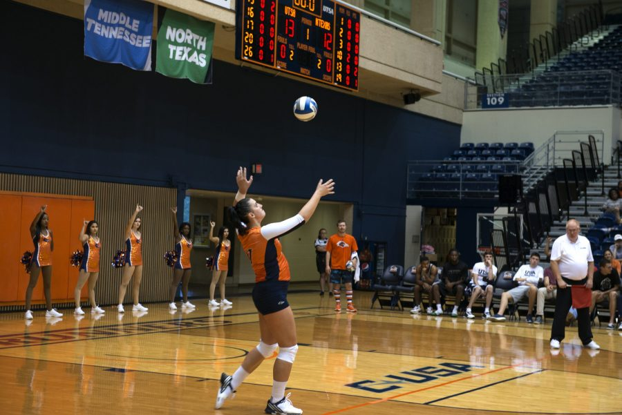 UTSA+cheerleaders+hold+their+birds+up+as+senior+outside+hitter+Dajana+Boskovic+serves.+Boskovic+has+helped+lead+the+Roadrunners+thus+far+to+a+18-6+record+with+two+conference+games+left.+Ethan+Pham%2C+The+Paisano