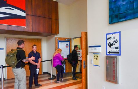 Students wait in line to cast early ballots in the Bexar Room. Isaac Serna, The Paisano