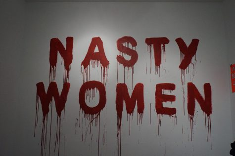 The new feminist battlecry is painted on AP Art Lab gallery wall. Photos by Raquel E. Alonzo