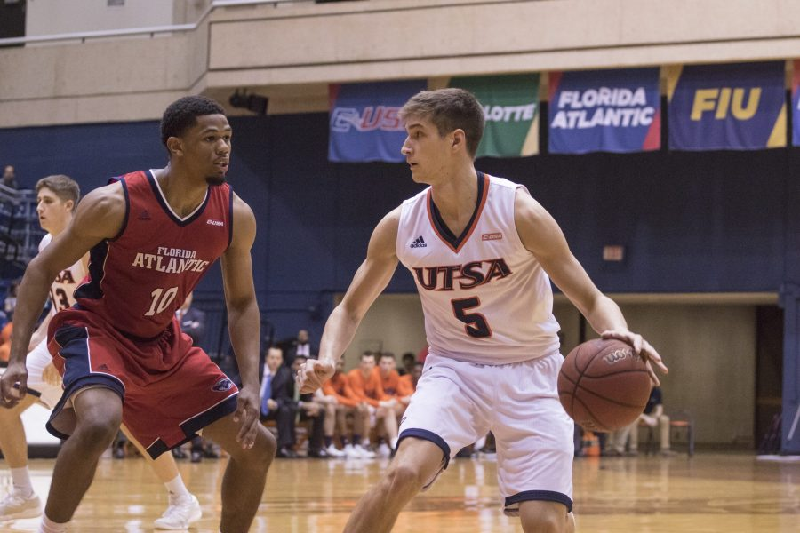Freshman guard Giovani De Nicolao dribbles and scans the FAU defense. Tristan Ipock, The Paisano