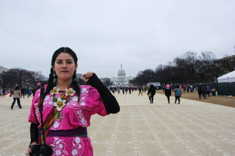 Brianna Orta raises a fist in solidarity. Brianna Orta, The Paisano