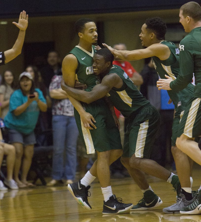 Charlotte+guard+Jon+Davis+is+congratulated+by+teammates+after+his+game-winning+three-pointer+