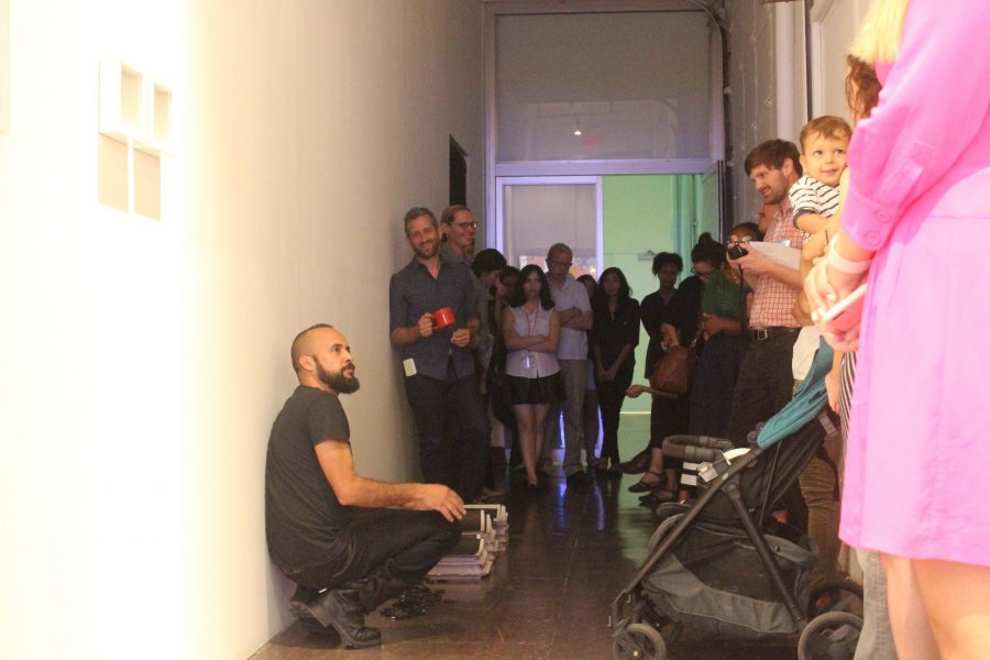 Rolando Lopez describing his work. Photos by Ben Shirani.