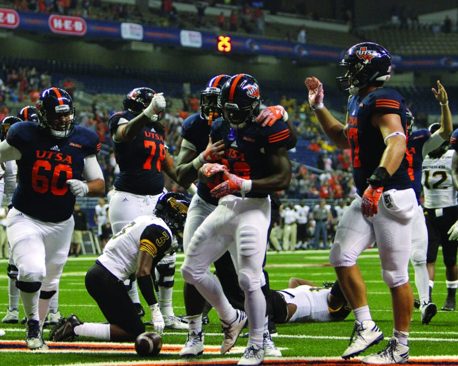 UTSA+celebrates+after+scoring+a+touchdown+on+Southern+Miss.+David+Guel%2C+The+Paisano