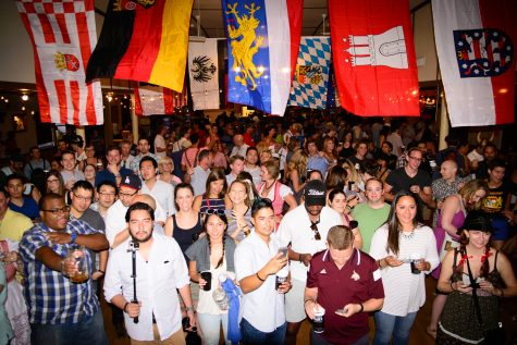 Oktoberfest attendees pose, drink and dance beneath German state flags. Germany is composed of 16 states. Oktoberfest originated in Bavaria, the largest German state. Courtesy of Austoberfest
