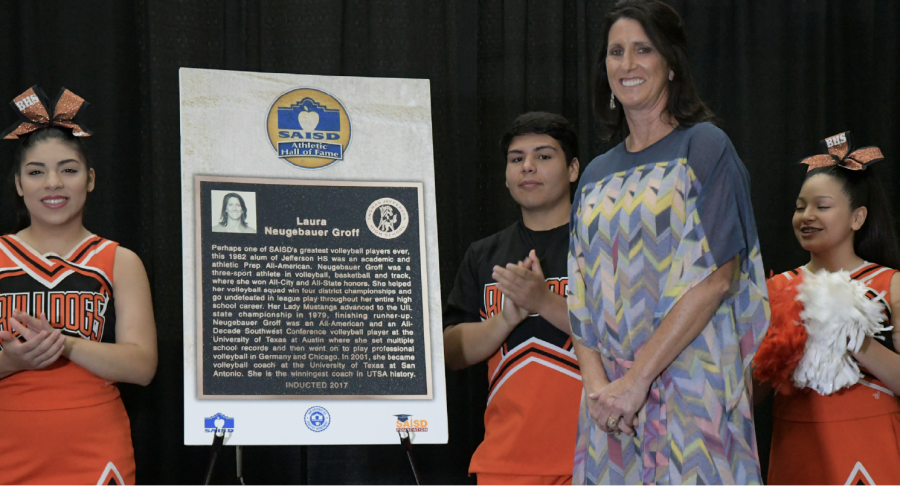 Groff poses for a photo next to her hall of fame plaque. Photo Courtesy of SAISD communications department.