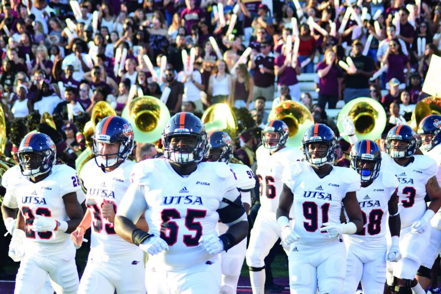 UTSA runs out onto the field at Bobcat Stadium in front of over 30,000 fans. Ricky Galindo, The Paisano