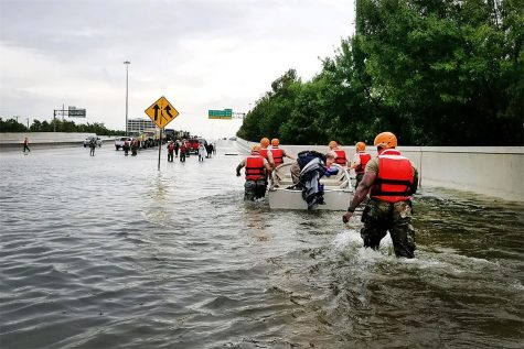 Rescuers gather on a flooded highway in Houston, Texas. Photo Courtesy of Creative Commons