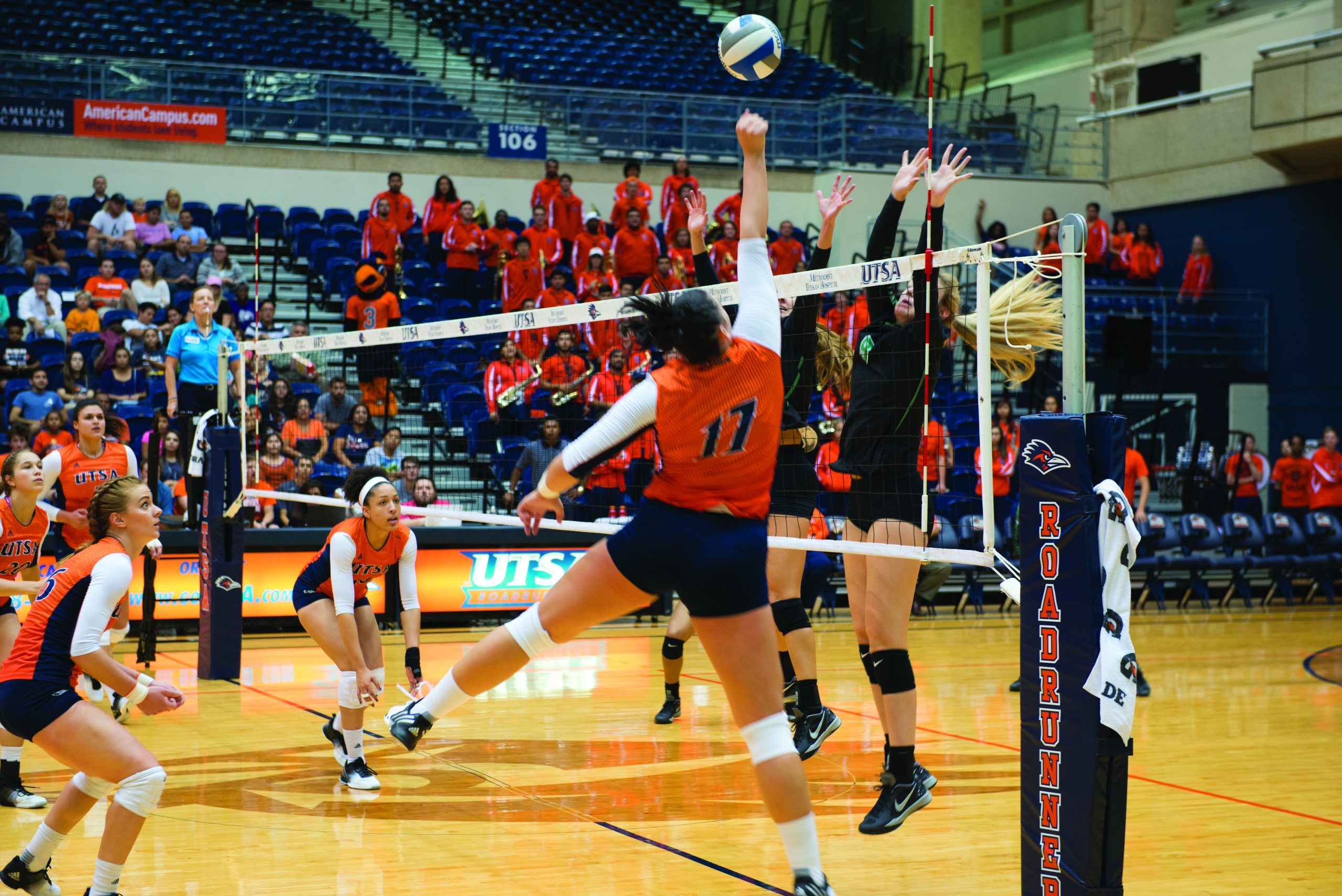 Montse Castro rises up to the net to spike the ball. Chase Otero/The Paisano