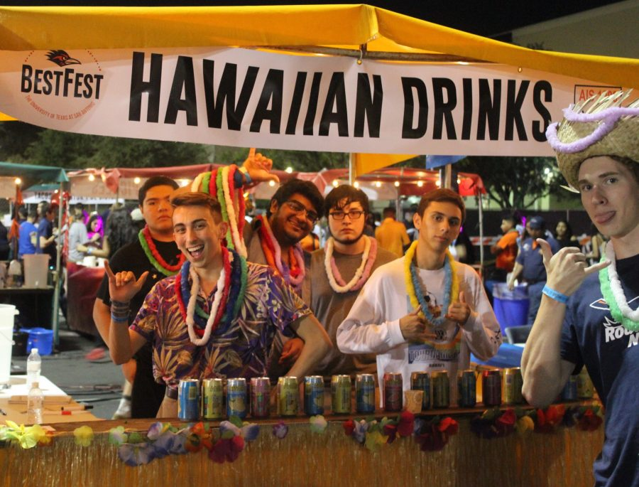 Students pose with their AIS Business Pathway booths for BestFest: TornadoPotato and Hawaiian Drinks. Ben Shirani/The Paisano