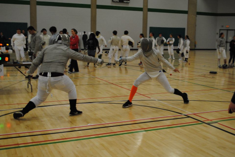 Nathaniel Sattler in a bout against A&M Corpus Christi.  Photo courtesy of UTSA club fencing