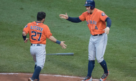 Altuve and Springer celebrate after they score a run. Keith Allison/Flickr.com