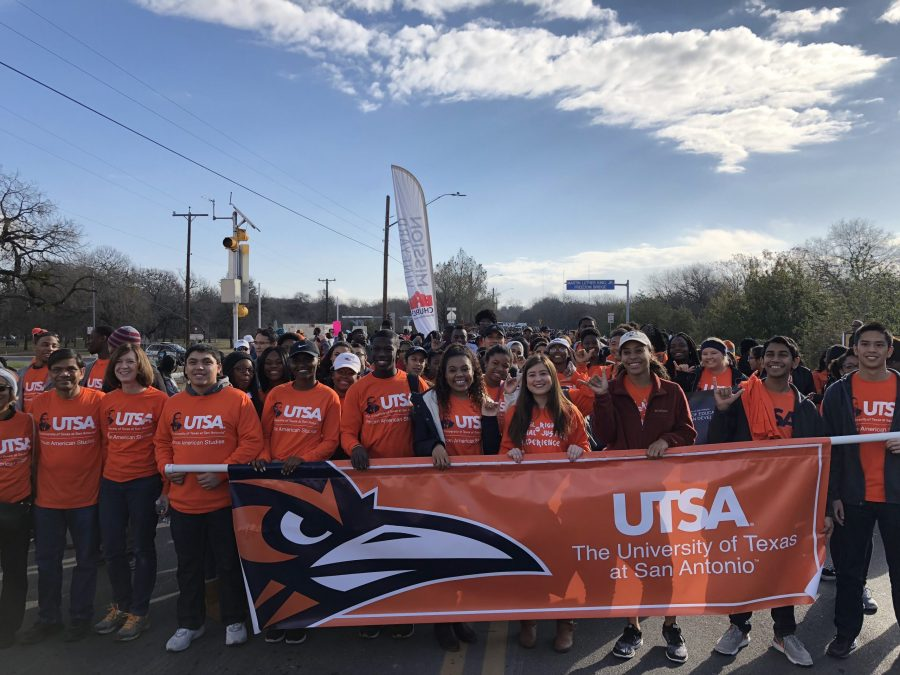 UTSA students carry a banner during the 31st annual San Antonio MLK March. Courtesy of Alejandro Lopez/The Paisano