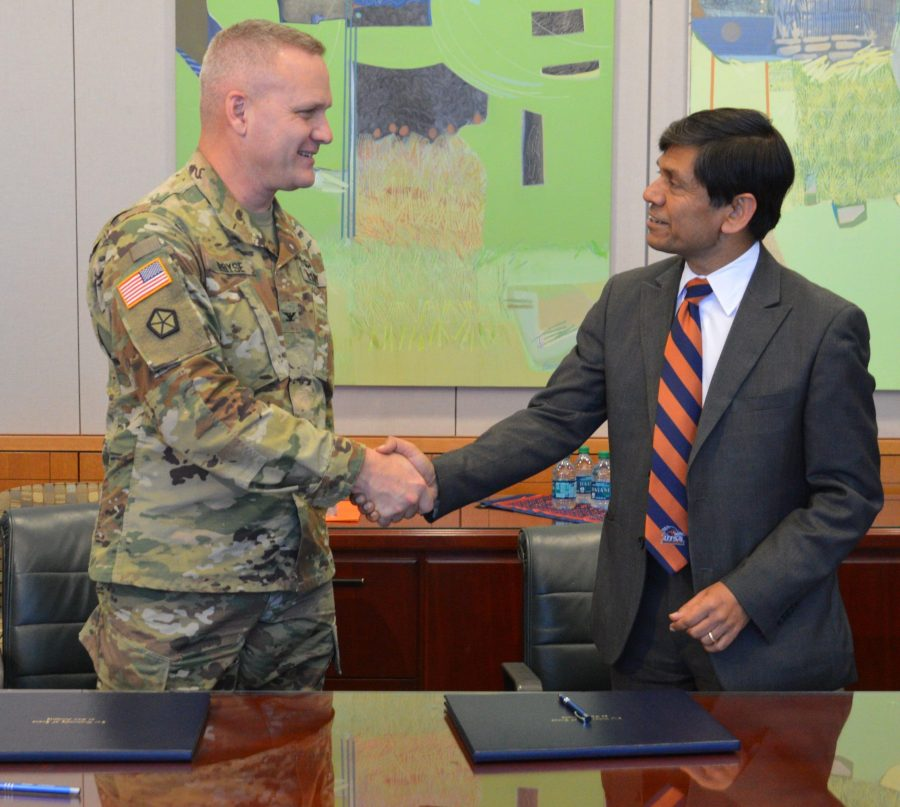Former UTSA interim Provost and Vice President of Academic Affairs, Mauli Agrawal, shakes hands with military personnel. Photo courtesy of The Creative Commons