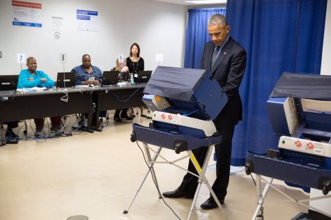 Former President Barack Obama votes on an the electronic voting system common in U.S. elections Photo Courtesy of Creative Commons