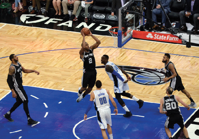 Kawhi Leonard rises up for a dunk in a game against the Magic. Jose Garcia/Flickr.com