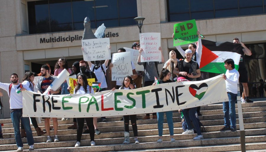 SJP+members+protest+the+Israel+Block+Party+in+front+of+the+Rowdy+Roadrunner+statue.+Heather+Montoya%2FThe+Paisano.