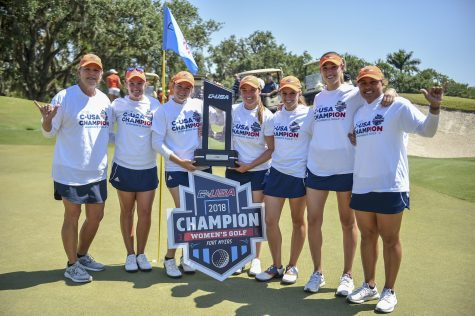 The team hoists their championship trophy after the win. Photo courtesy of Conference-USA