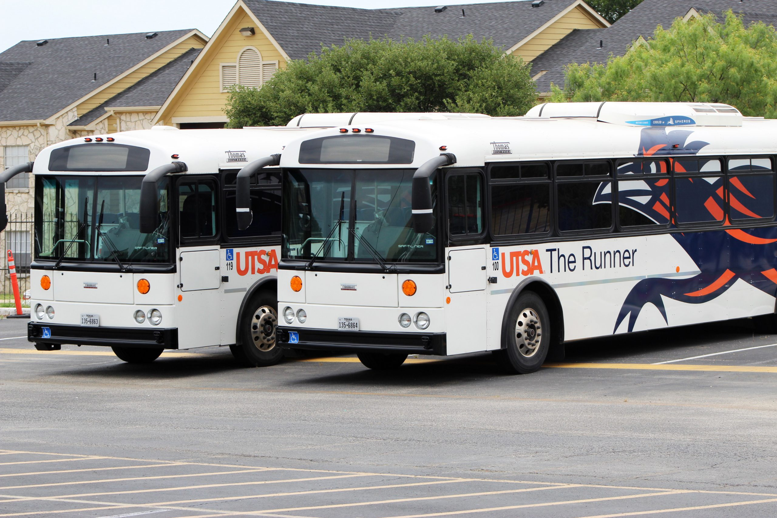 UTSA shuttles parked in Brakenridge Parking Lot 1.  Ricky Galindo/The Paisano
