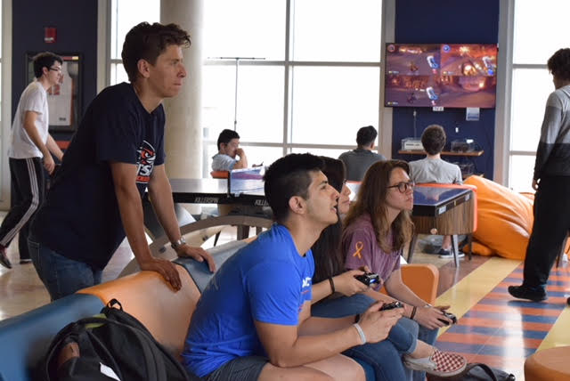 Students play video games in The Roost, which feature over 50 different videos games to play from. Photo courtesy of UTSA Student Union