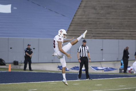 Routsas getting a punt off against Rice.