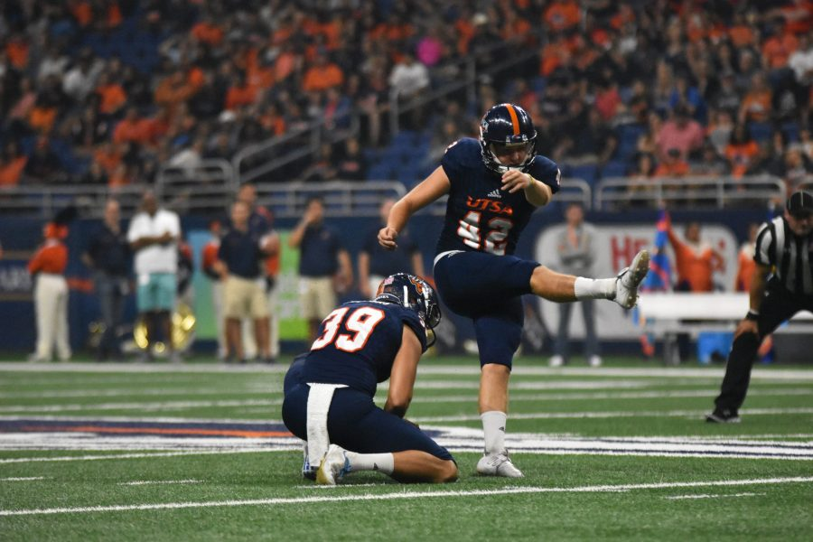 Jared Sackett kicking a field goal before halftime against UTEP