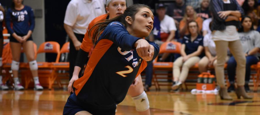 Emily Ramirez hitting a ball during a game.