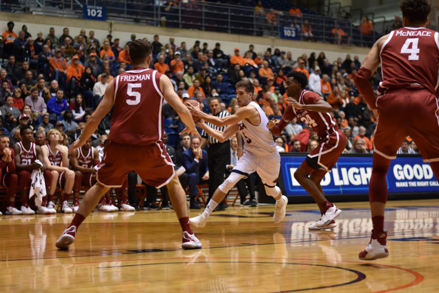 Guard Giovanni De Nicolao dribbles past some Oklahoma Sooners on his way to the rim. Jack Myer / The Paisano