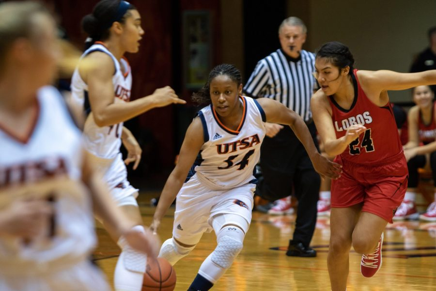 Guard+Karrington+Donald+races+her+way+past+several+defenders+in+a+game+against+Sul+Ross+State.