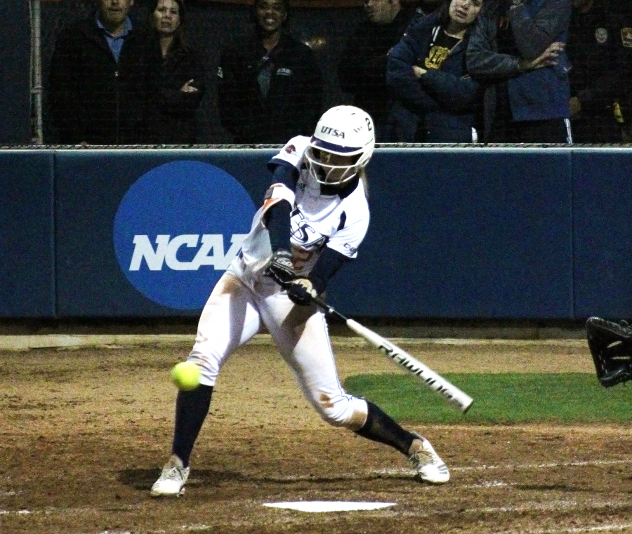 Celeste Loughman takes a swing at a pitch to get on base.
