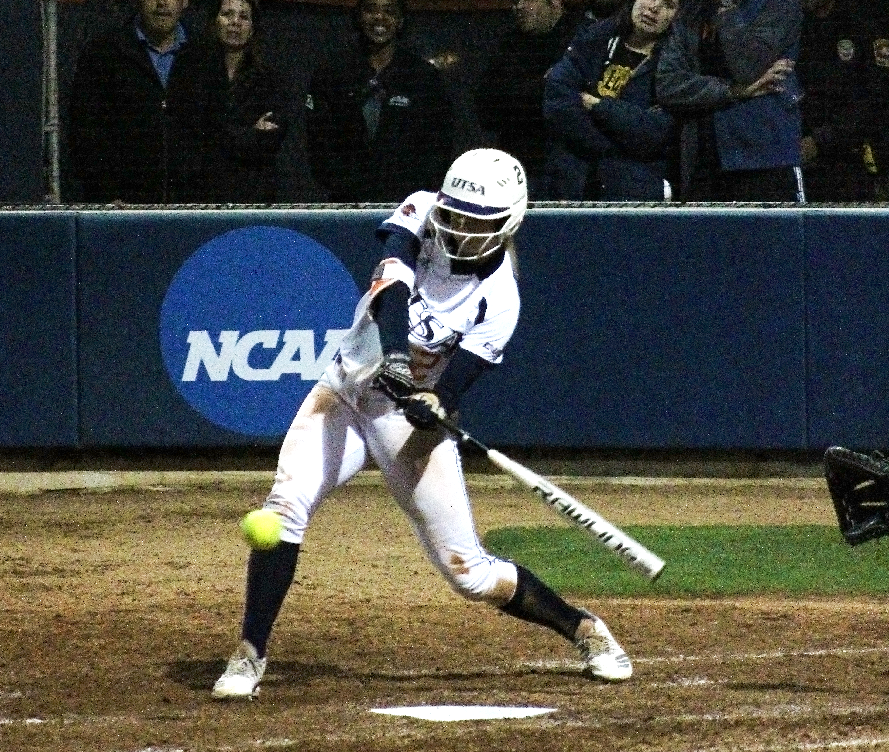 Celeste Loughman takes a swing at a pitch to get on base. Ethan Gullett/UTSA Athletics