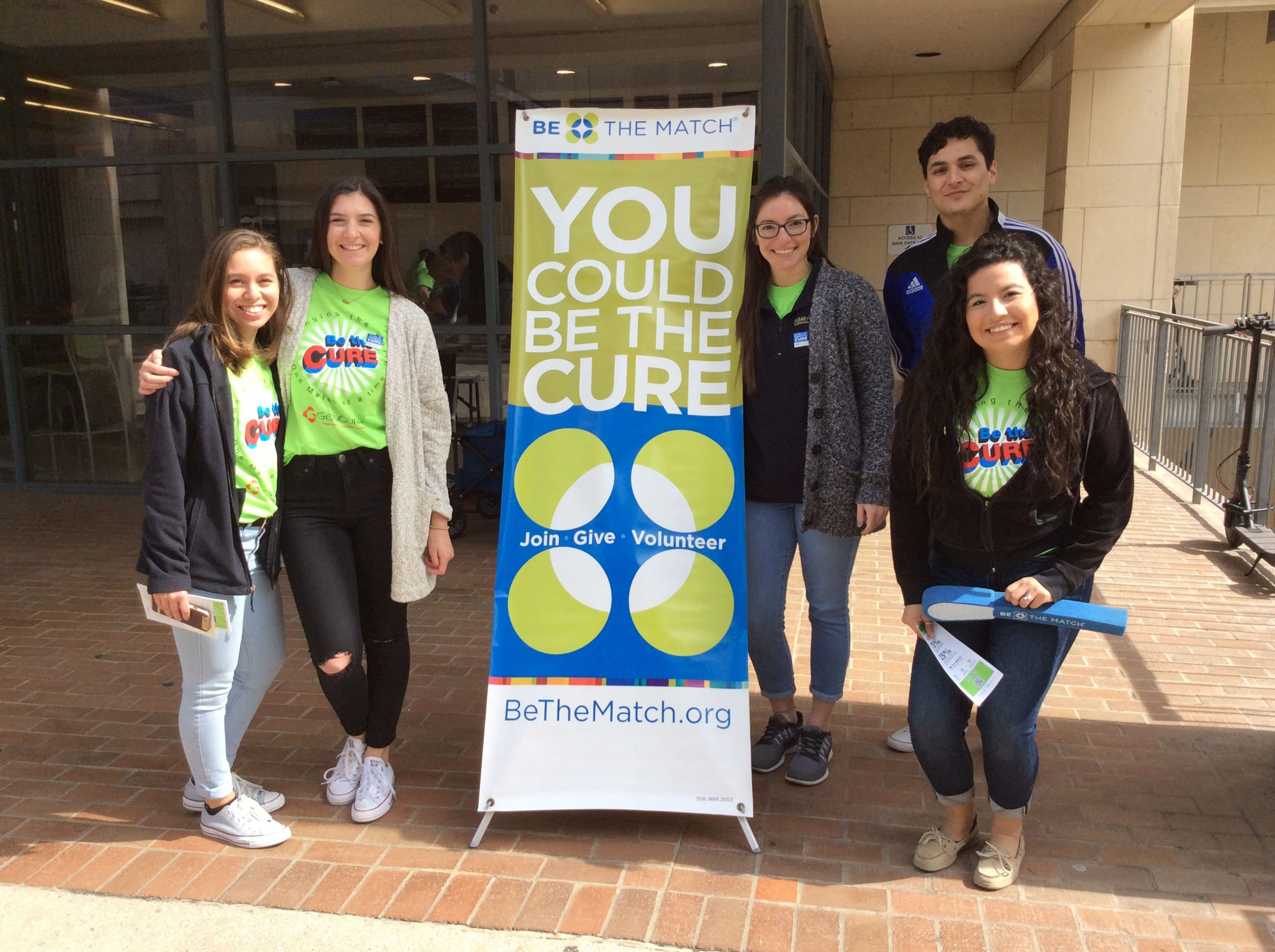 Student volunteers table outside the Business Building.  Photo Courtesy of GenCure