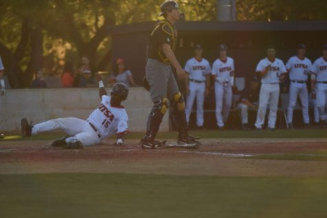Bryan Sturges slides in at home place.  Jack Myer/The Paisano