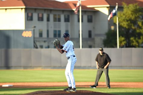 A.G. Yowell pitches the ball.