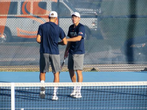 Men's tennis gets first win, women lose at Arlington