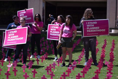 Students for Planned Parenthood stand in Students For Life demonstration.