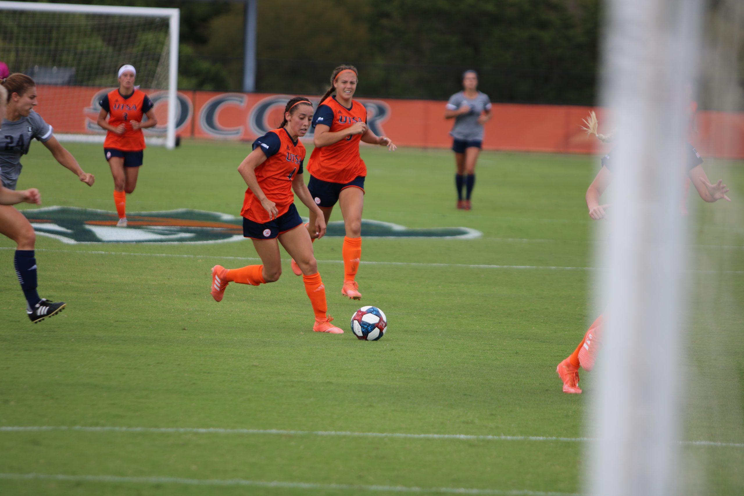 Lexi Bolton runs after a ball. Photo by Donald Escamilla