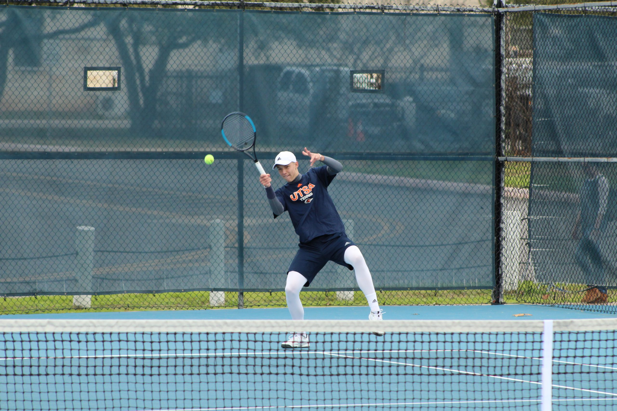 Juri Reckrow receives a serve against his opponent. Photo by Ethan Gullet