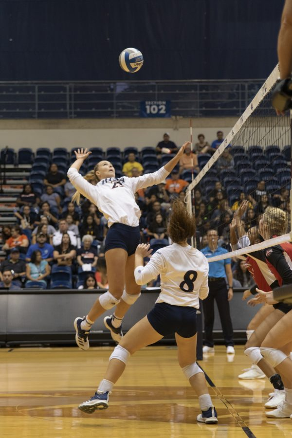 Madeline McKay swings at a set from Courtney Walters. Photo by Lindsey Thomas