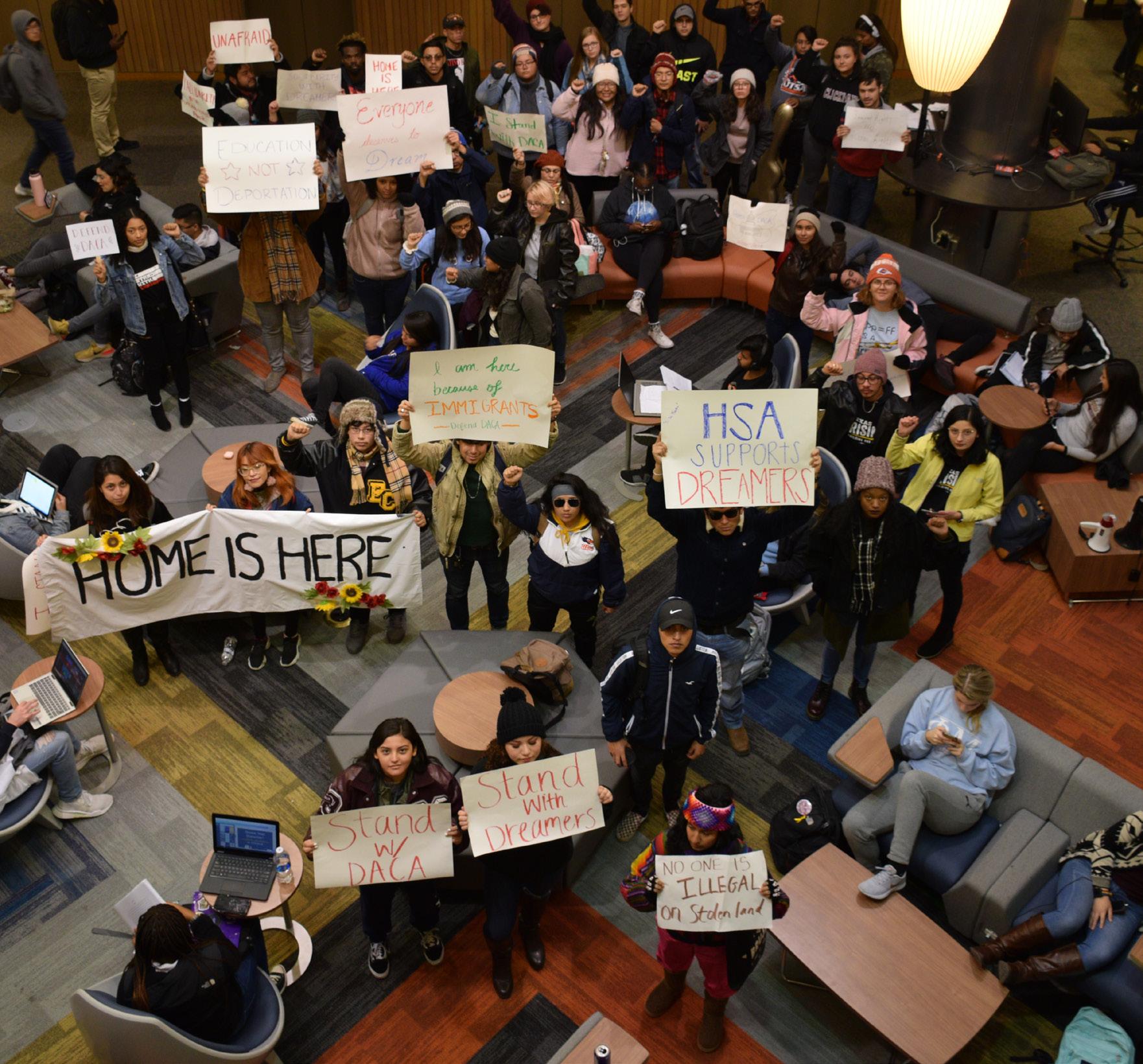 Protestors support DACA inside John Peace Library. Photo courtesy of John Dye