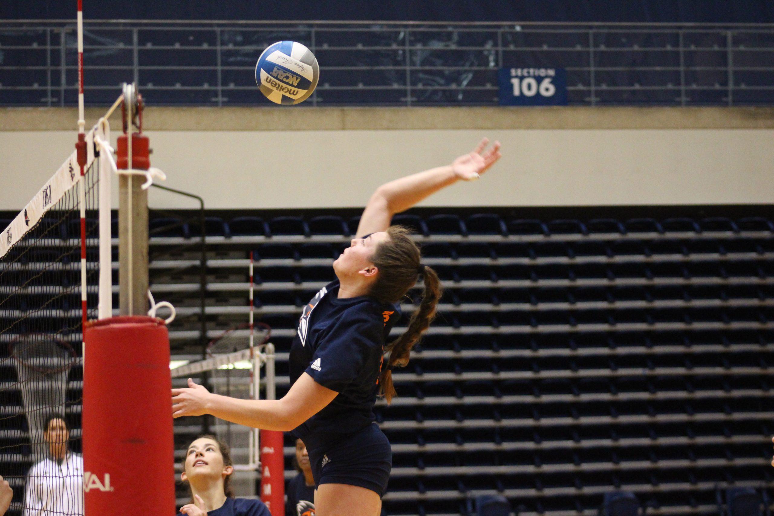 Jenna Patton hits the ball over the net. Julia Maenius/The Paisano