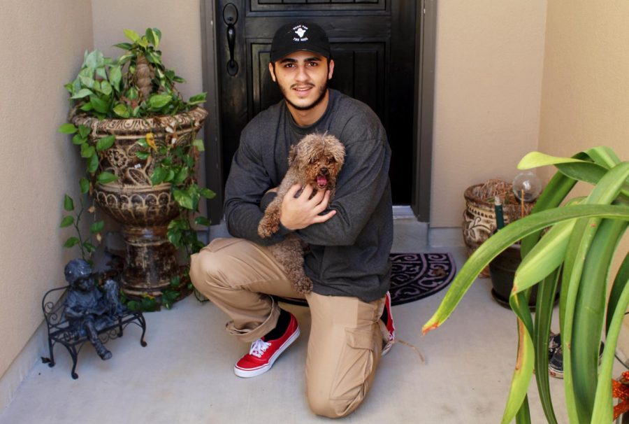 Najjar poses with his dog, Mocha. Photo Courtesy of Faisal Najjar