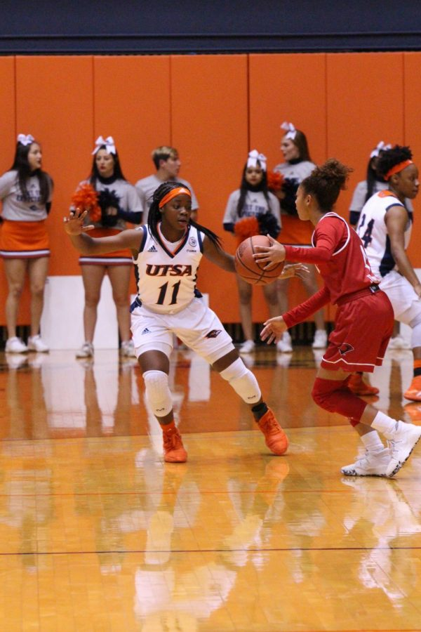 Charlene Mass defends the basket against the Cardinals.