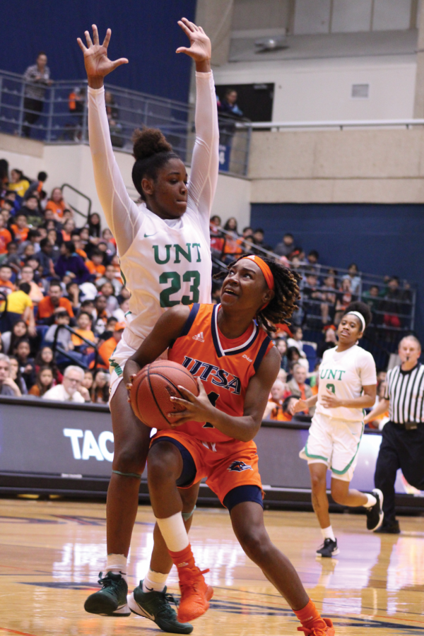 Mikayla Woods drives around defenders to the rim with the ball. During a game against the University of North Texas on January 23, the 'Runners fell to the Mean Green, 55-79.