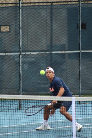 Alan Sanson prepares to return a serve. The men's tennis team split their first match of the spring season in California.