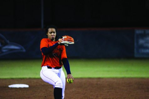 Marena Estell pitches the ball during warm-ups. The softball team began their 2020 season on the road in Louisiana.